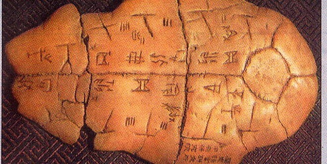 inscriptions on bones or tortoise shells of the Shang Dynasty